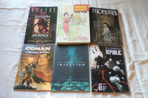 Seven paper back comics and one hard cover, all for $40