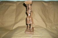 wood carving of bread lady