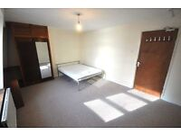 Spacious 4 double bedroom flat located in Warren St fitted kitchen shower room GCH carpeted & More..