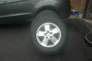 4 Snow Tires - 235/70R/16 Ford Escape Factory Alum. Rims