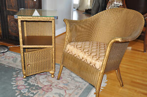Wicker chair and glass topped side table made by Lloyd Loom