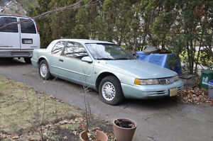 1994 near perfect condition teal Mercury Cougar