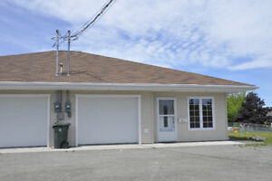 2 bedroom duplex with garage in a great location