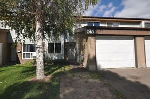 Attractive 2 Storey Townhouse Condo With WALK-OUT Basement