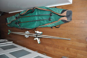 countris skis and poles and casing