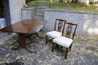 Antique dinning room table, 6 chairs and a custom dover pad