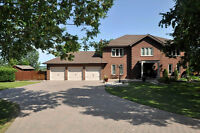 RENOVATED HOME ON 1.5 ACRES BACKING ONTO GOLF COURSE