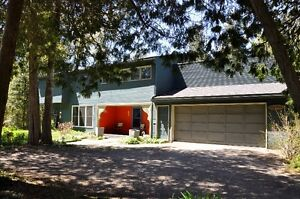 Over 2000 Sq. Ft. Multi Level Home Set on 4.19 Acres Along Grand