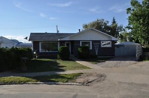 BEAUTIFUL NIPAWIN BUNGALOW ON A LARGE LOT WITH DREAM GARAGE