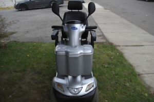 Invacare Pegasus 4 wheel mobility scooterwith charger, front ba