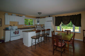 Large open concept home/cottage on acre of land, private!