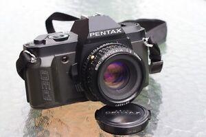 Pentax  cameras and lenses (like Pentax K1000, or better)