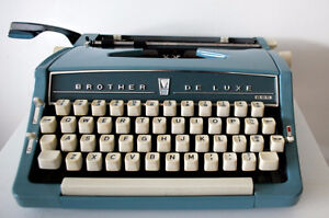 Vintage Brother DeLuxe powder blue portable typewriter With case