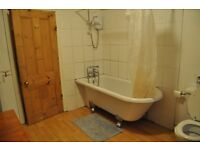 Free standing corner Bath with claw feet and shower mixer