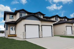 Brand New With Finished Attached Garage In Penhold!