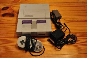 Super Nintendo avec 1 manette et 3 jeux
