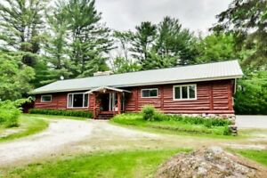 Log house 2031 square feet in a wooded pine trees
