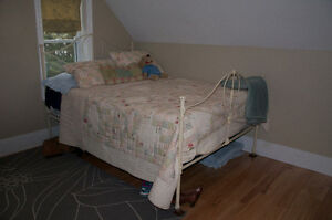 Rod Iron bed with double box spring and mattress