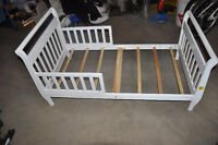 Toddler bed. Use your crib mattress!