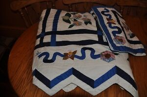 Queen size quilted bed spread with matching shams