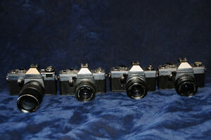 Choice of 4 Praktica Cameras with lens