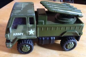 "WT. ROCKET LAUNCHER MILITARY TRUCK. DIECAST 4"" long 1:43"