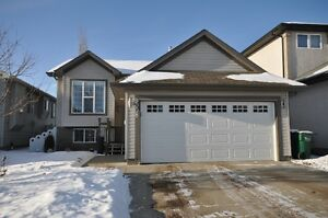 COMPLETELY MOVE IN READY! Fully Finished Bi-level 4 bed, 3 bath
