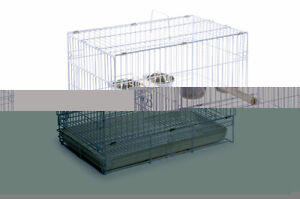 Two white travel cages