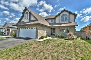 Custom home backing onto Ravine with full INLAW SUITE!