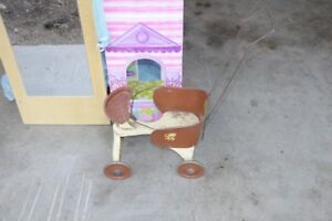 Antique toy baby stroller