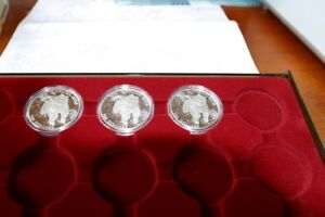 4 $20 for $20 Silver coins & 3  $100 for $100Silver coi ns