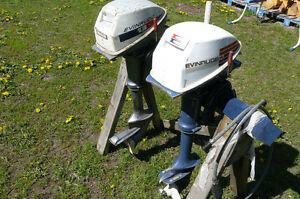 Two Evinrude outboard motors