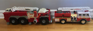 Two tonka fire trucks