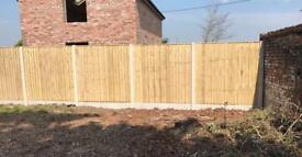 Pressure treated vertical board heavy duty wooden fence panels.
