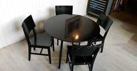 Pending Collection Round Black Dining Table and 4 Chairs