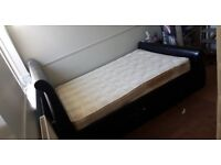 Double bed,black leather.