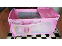 Pink travel cot