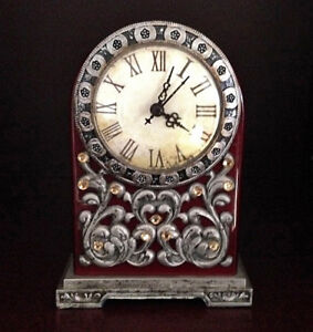 Antique Style wooden mahogany Mantel Clock detailed with pewter
