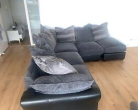 Large grey and black corner sofa , fabric and leather
