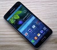 GREY SAMSUNG GALAXY S5 WITH CHARGER - KOODO/TELUS