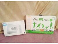 Boxed Nintendo Wii with boxed Wii fit board