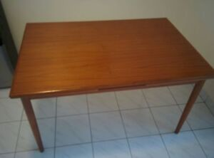 Extendable Teak Wood dining table with 4 chairs.