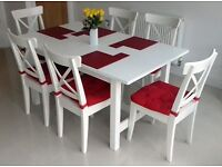Ikea extending white dining table and 6 chairs