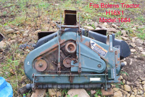 Two Bolens mower decks for sale.