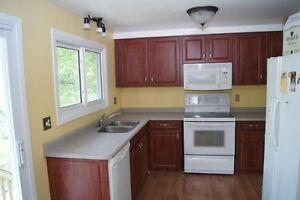Bright well maintained detached home.  Large deck and back yard