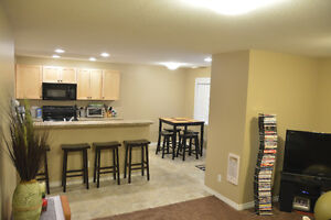 Airdrie - Bright Sunny 1 Bedroom Suite with covered deck & shed