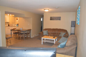 Spacious Two Bedroom Basement Suite - Walking Distance to RDC