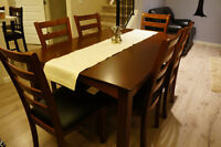 solid wood (heavy) with build-in leaf + 6chairs faux leather