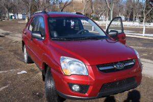2009 Kia Sportage Remote starter, Brand New Tire and  Windshield
