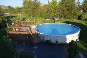 27' Diameter Above Ground Pool including a Beautiful Wood Deck